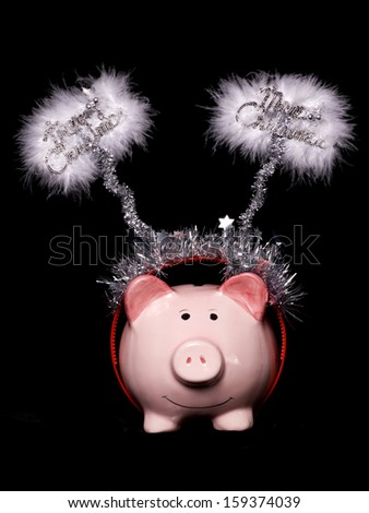Piggy bank with christmas head band studio cutout - stock photo