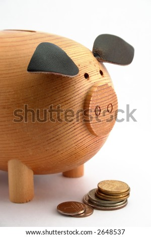 Piggy bank with coins isolated on white background - stock photo