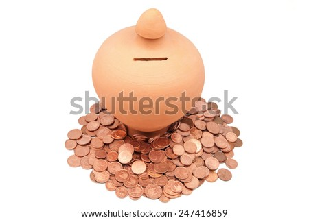 piggy bank with coins on a white background - stock photo