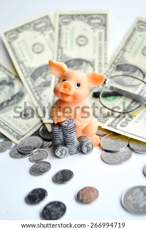 piggy Bank with coins on a white background,Finance,money
