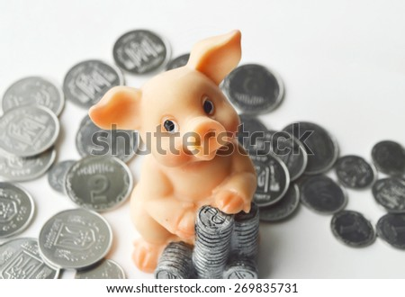 piggy Bank with coins on a white background,Finance,money - stock photo