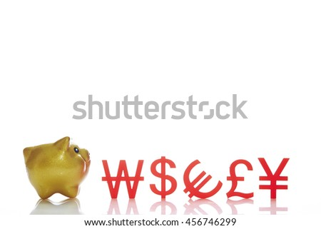 Piggy bank with currency symbols - stock photo