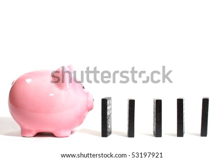 Piggy bank with dominoes - stock photo