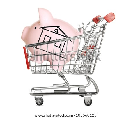 Piggy bank with drawn house in shopping cart  Isolated - stock photo