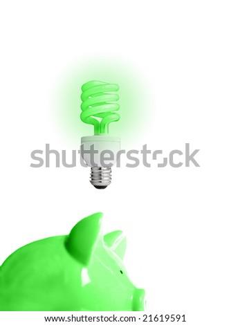 piggy bank with energy-efficient light-bulb above (smart energy) - stock photo