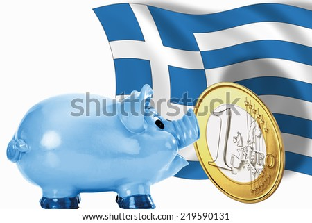 Piggy bank with 1 euro coin and greek flag - stock photo