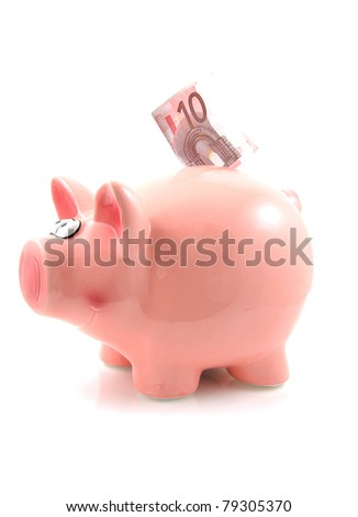 Piggy bank with euro money over white background