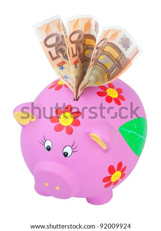 Piggy bank with euro notes. Isolated on a white with clipping paths. - stock photo