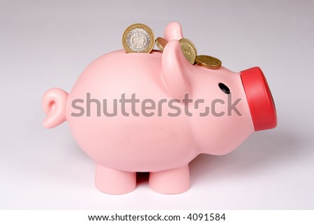 Piggy bank with few coins.