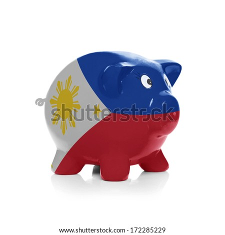 Piggy bank with flag coating over it isolated on white - Philippines - stock photo