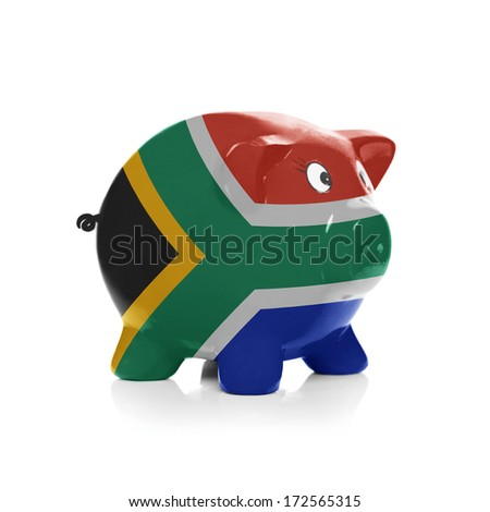 Piggy bank with flag coating over it isolated on white - South Africa - stock photo