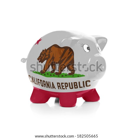Piggy bank with flag coating over it isolated on white - State of California - stock photo