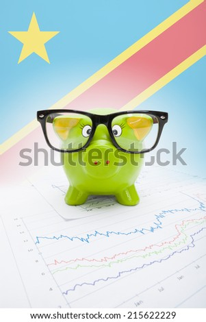 Piggy bank with flag on background - Democratic Republic of the Congo - stock photo