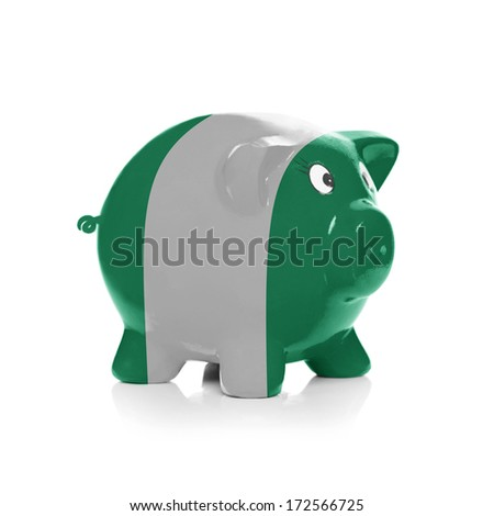 Piggy bank with flag painted over it isolated on white - Nigeria - stock photo