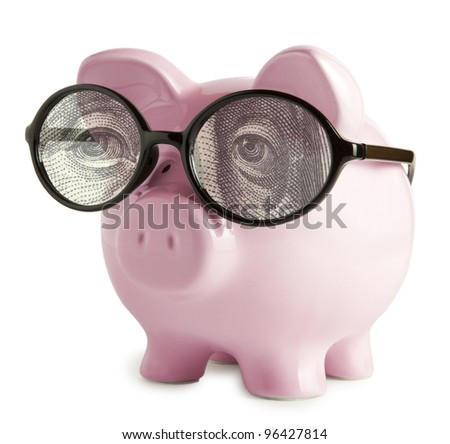 Piggy bank with glasses in isolated white background  Franklin's eyes concepts - stock photo