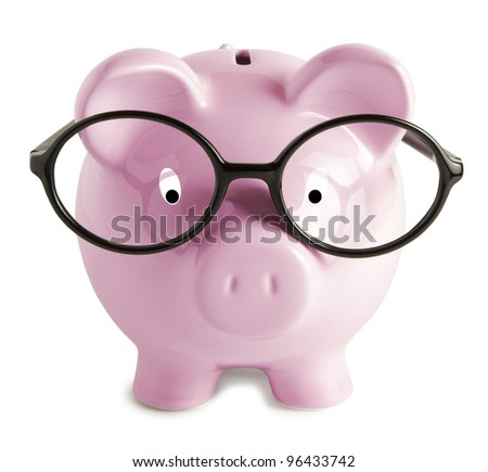 Piggy bank with glasses isolated - stock photo