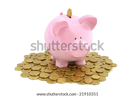 Piggy bank with golden coins, isolated on white. - stock photo