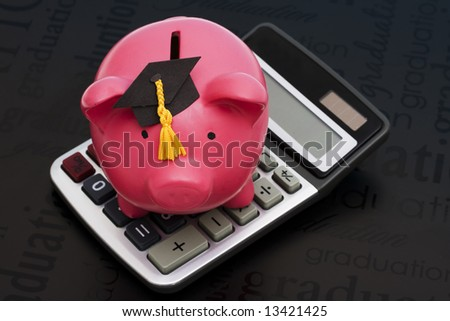 Piggy bank with graduation cap and calculator - stock photo