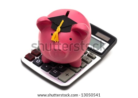 Piggy bank with graduation cap and calculator isolated on white - stock photo
