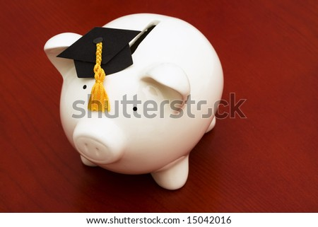 Piggy bank with graduation cap â?? cost of education - stock photo
