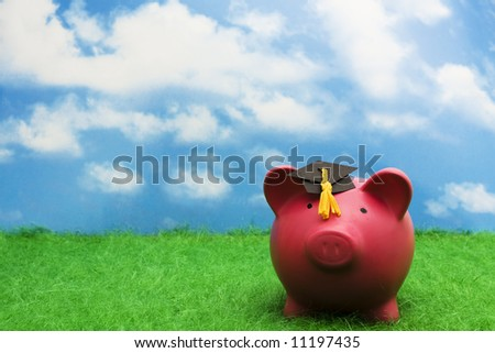Piggy bank with graduation cap with sky background - stock photo
