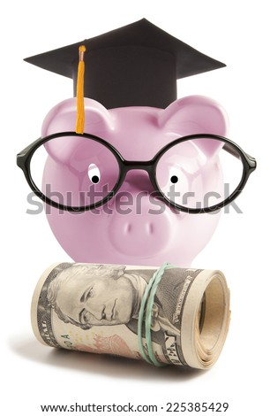 Piggy bank with graduation hat. Isolated on white background - stock photo