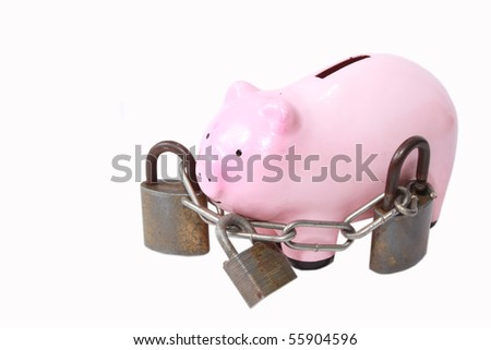 Piggy bank with heavy locks - stock photo