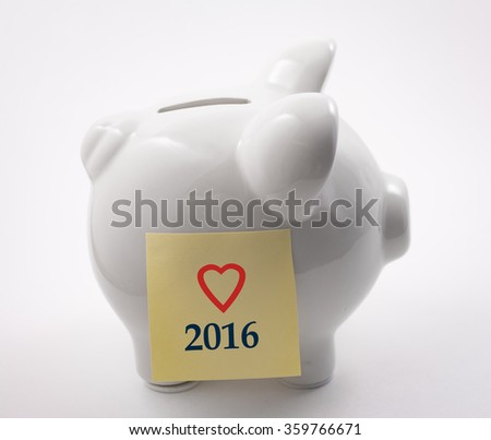 Piggy bank with I love 2016 post it note  - stock photo