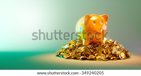 Piggy bank with large stack of money - stock photo