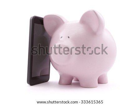 Piggy bank with mobile phone. Clipping path included.  - stock photo