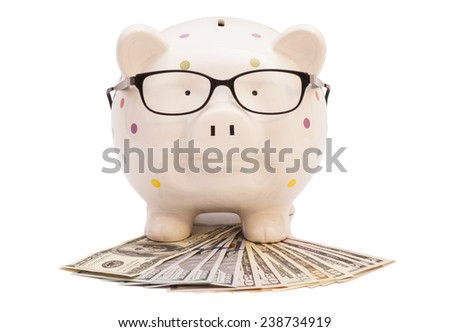 Piggy bank  with money and glasses isolated on  white  background  - stock photo