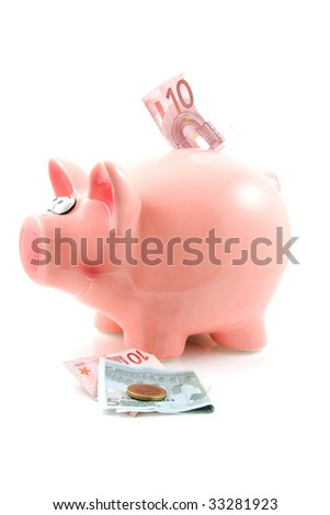 Piggy bank with money isolated on white background