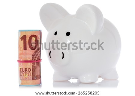 Piggy bank with money roll, isolated on white background - stock photo