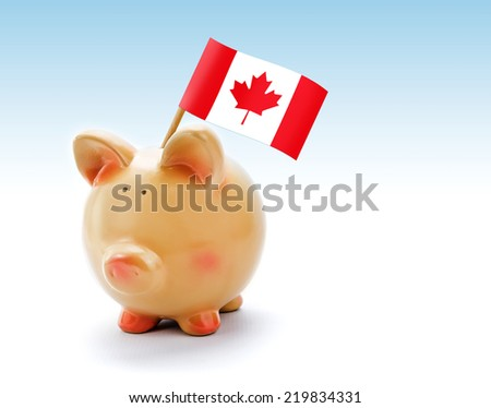 Piggy bank with national flag of Canada - stock photo
