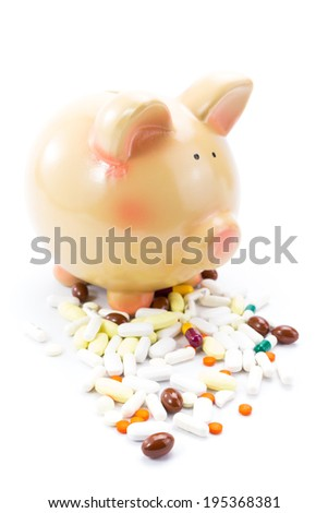 Piggy bank with pile of pills isolated on white  - stock photo