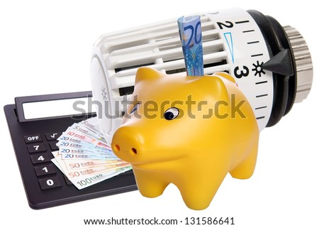 Piggy bank with radiator thermostat / heating costs - stock photo