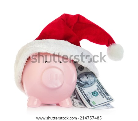 Piggy bank with Santa Claus hat and money on white background - stock photo