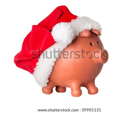 Piggy bank with Santa Claus hat isolated on white - stock photo
