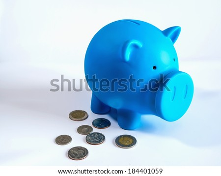 Piggy bank with silver coin on white isolated background - stock photo