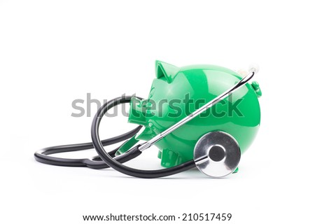 Piggy bank with stethoscope - stock photo