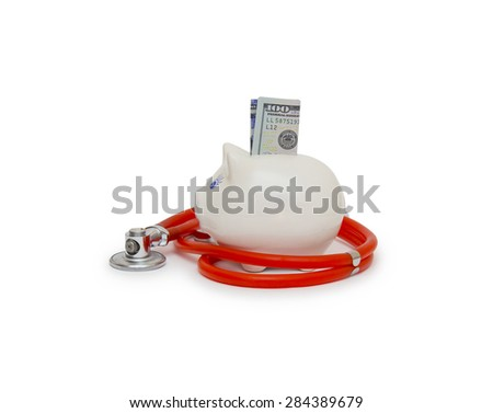 piggy bank with stethoscope isolated on white - stock photo