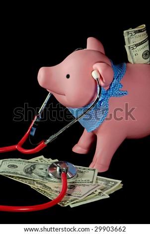 piggy bank with stethoscope on money - stock photo