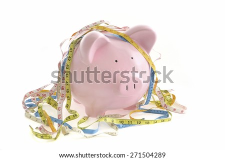 Piggy Bank with tape measures on White Background - stock photo