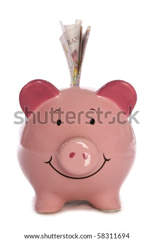 Piggy bank with ten pound sterling studio cutout - stock photo