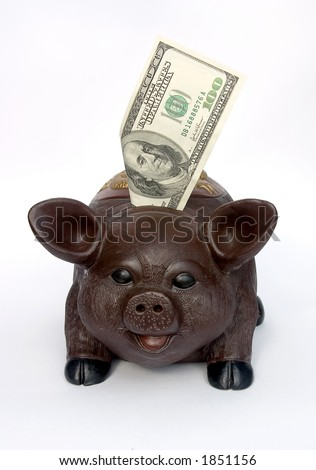 Piggy bank with U.S. one hundred dollars in slot.Isolated on white. - stock photo