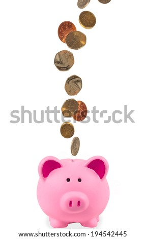 Piggy bank with uk currency - stock photo