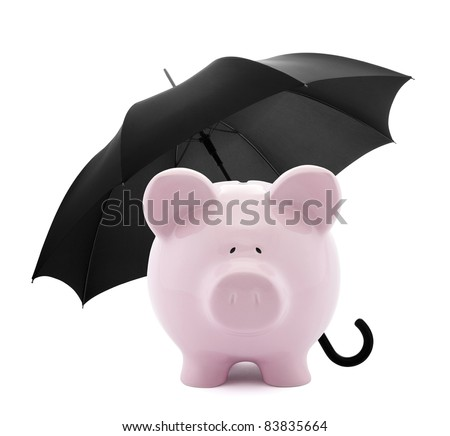 Piggy bank with umbrella - stock photo