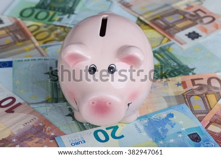 Piggy bank with with euro banknotes