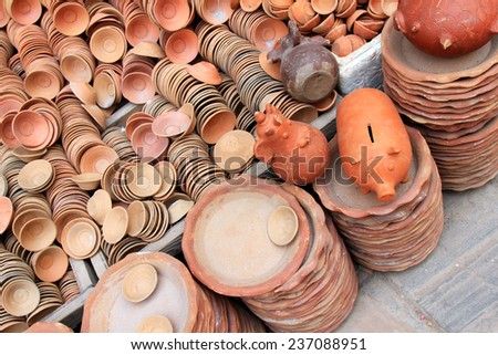 Piggy Banks and other potteries made of clay for sale in Kathmandu, Nepal.  - stock photo