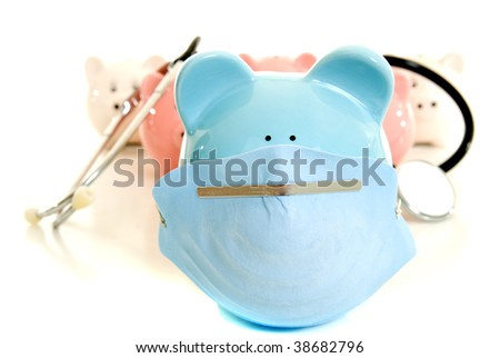 Piggy banks with a stethoscope in a swine flu concept